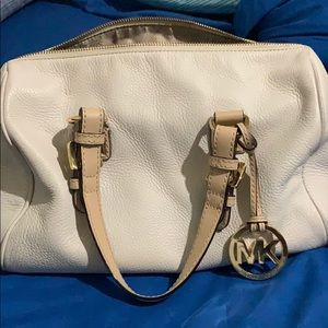 Bone color Michael kors! No rips inside or out.